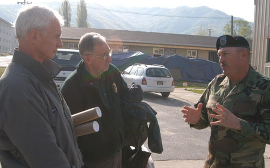 """Command Sgt. Maj. James Lucero (right) explains """"sergeant's time"""" training to Association of the US Army representatives Jim Ryan (left) and Norm Harkins."""