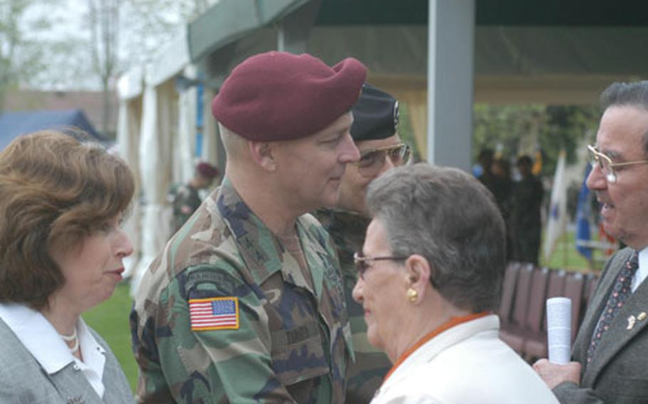 Maj. Gen. Thomas R. Turner and his wife, Susan, say their goodbyes to a long line of people Friday following a change-of-command ceremony at Caserma Ederle in Vicenza, Italy.