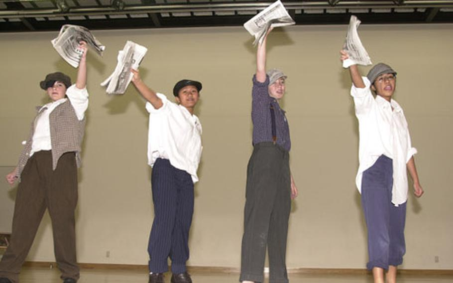"""Ashley Bailey,13; Karen """"Kayzelle"""" Pickens, 14; Meagan Everston, 13; and Geraldine Fiesta, 14, 8th graders at Yokosuka Middle School, finish their Newsboy Strike of 1899 performance for the National History Day competition. They finished in second place."""