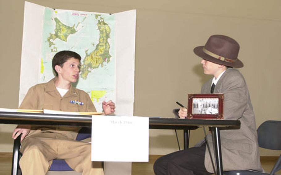 Gen. Douglas McArthur (Matthew Duncan, 13) explains his post-World War II policies to Edward R. Murrow (Calvin Dockendorff) during the National History Day Event at Yokosuka Middle School. Duncan and Dockendorff, YMS 8th graders, won the performance category of the competition Friday.
