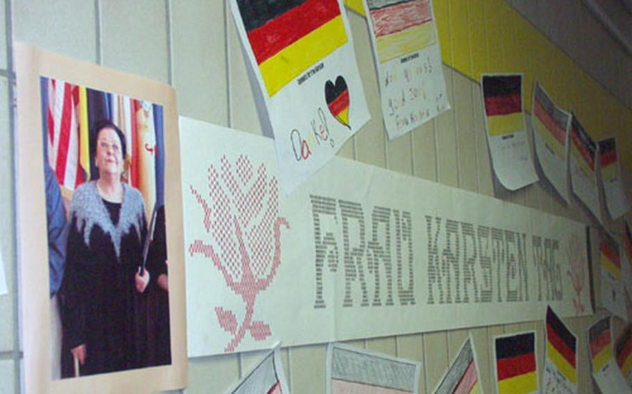 """Posters and tributes plaster the walls Friday at Würzburg Middle School, Germany, for """"Frau Karsten Tag."""" The school had prepared a surprise daylong tribute to Ursula Karsten, the school's German culture and language teacher, in honor of her 40 years of teaching for Department of Defense Dependents Schools."""