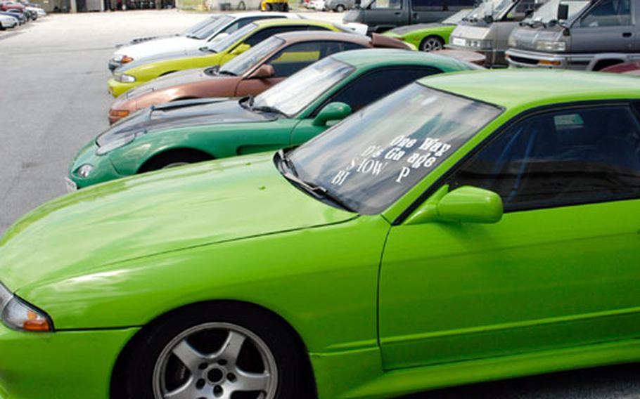 """Flashy cars sit idly at the Marine Provost Marshal's impound lot on Camp Kinser. The cars were impounded in a sting operation targetted at illegally street racing called """"drifting."""""""