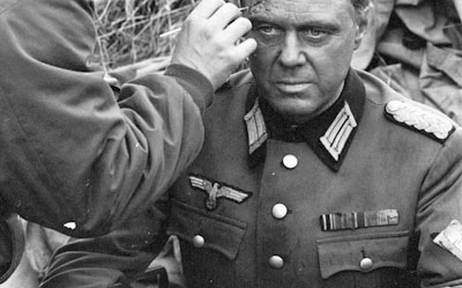 """Actor Marius Goring is made up for his role as a wounded German soldier in """"Up from the Beach."""""""