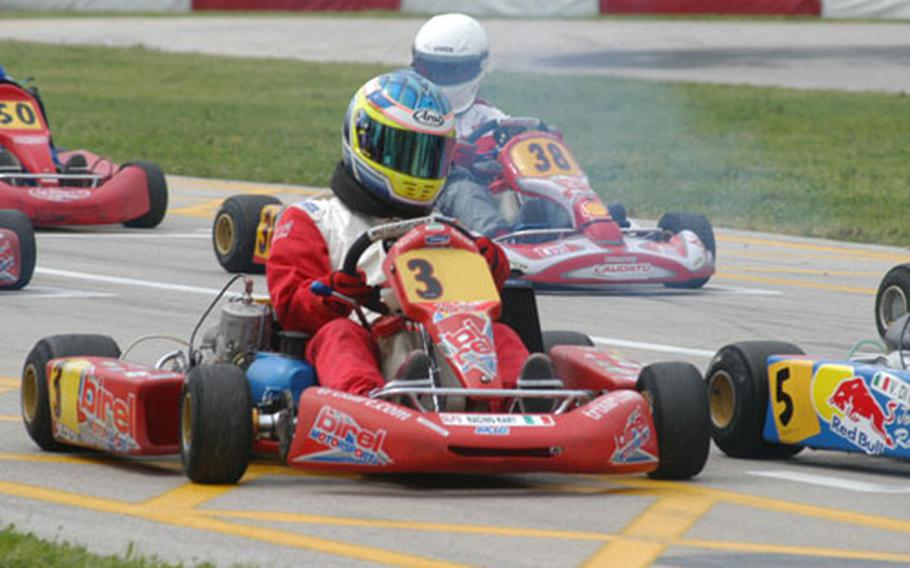 Paul Kloepping (No. 3) waits for his race to begin at a Go Kart track in Casaluce, near Naples, Italy. Kloepping regularly is the only American racer at tracks around Italy when the professionals race.