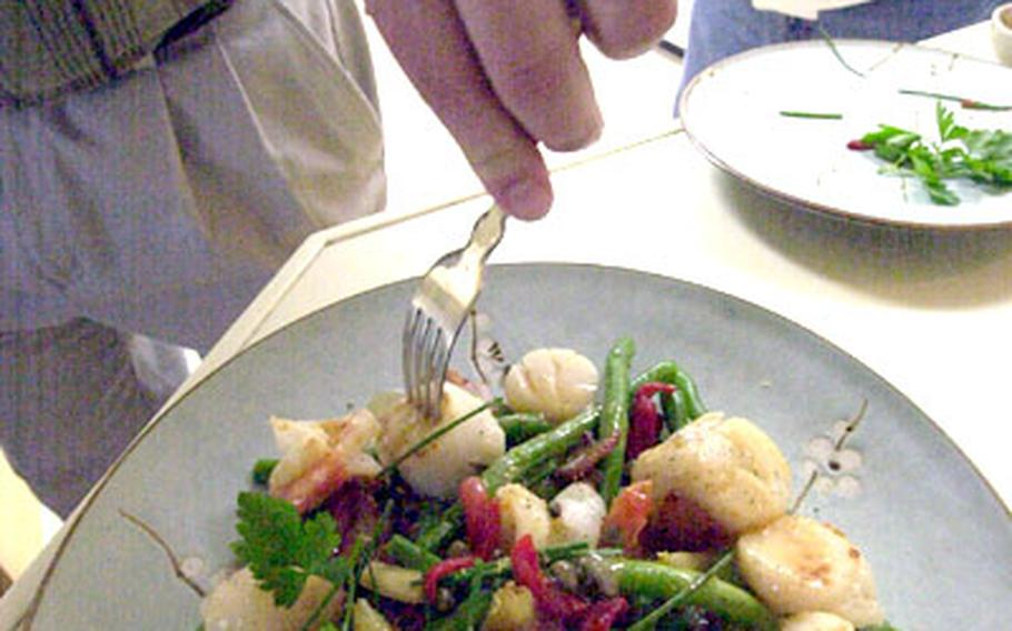 One of Pat McAndrew's creations, shrimp and scallops with green beans and chili sauce.