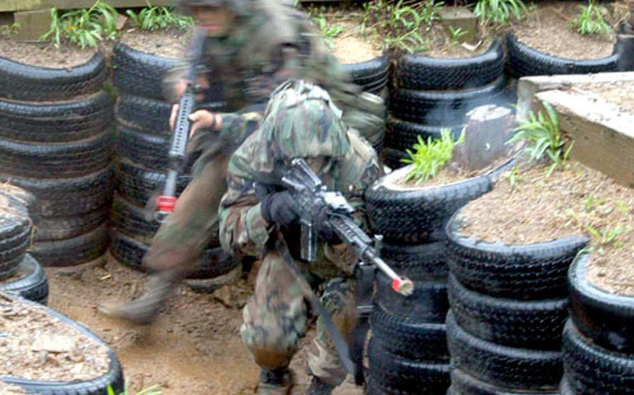 Soldiers move through a trench at Cherokee Valley as they practice a skill that would be needed in a conflict with North Korea. Rounding corners proved to be one of the most challenging tasks.