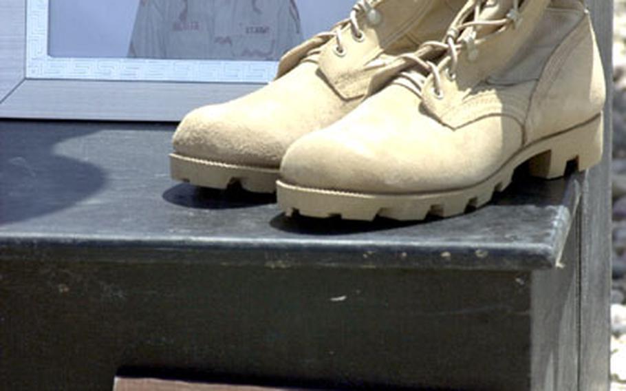 Pvt. Jeremy L. Drexler's boots, Purple Heart and Bronze Star Medal.