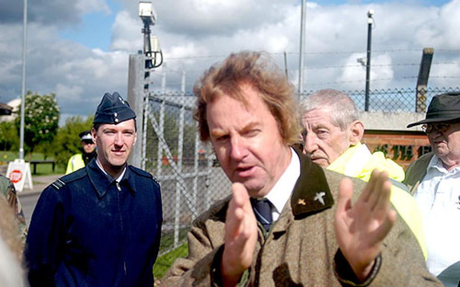 Royal Air Force Squadron Leader James Savage, left, listens Wednesday as Martin Storey, a local councilor, talks about traffic around RAF Feltwell, England. Local residents want traffic around the U.S. base cleared.