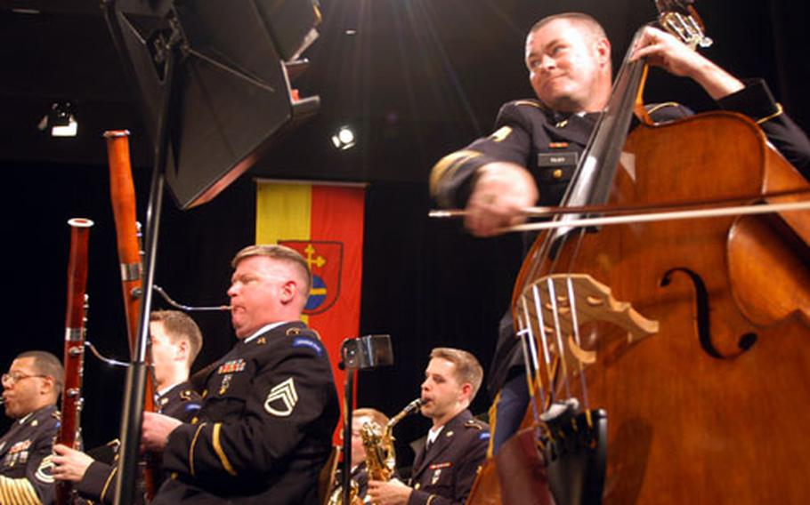 Sgt. 1st Class Larry Tilby, riding the bow across the strings of his bass, performs with the U.S. Army Europe Band on Sunday in Heidelberg, Germany. The band started a two-week road trip through the Balkans this week.