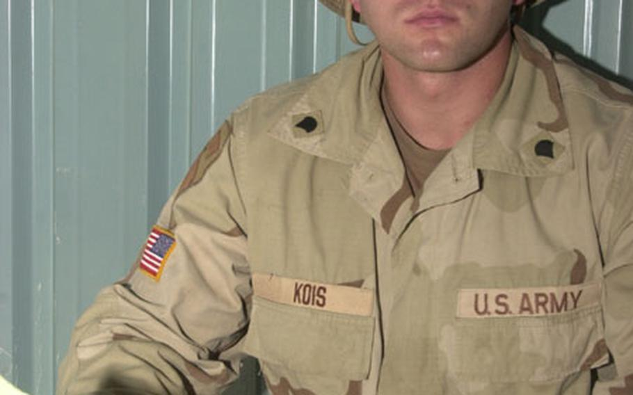 Spc. Craig Kois.