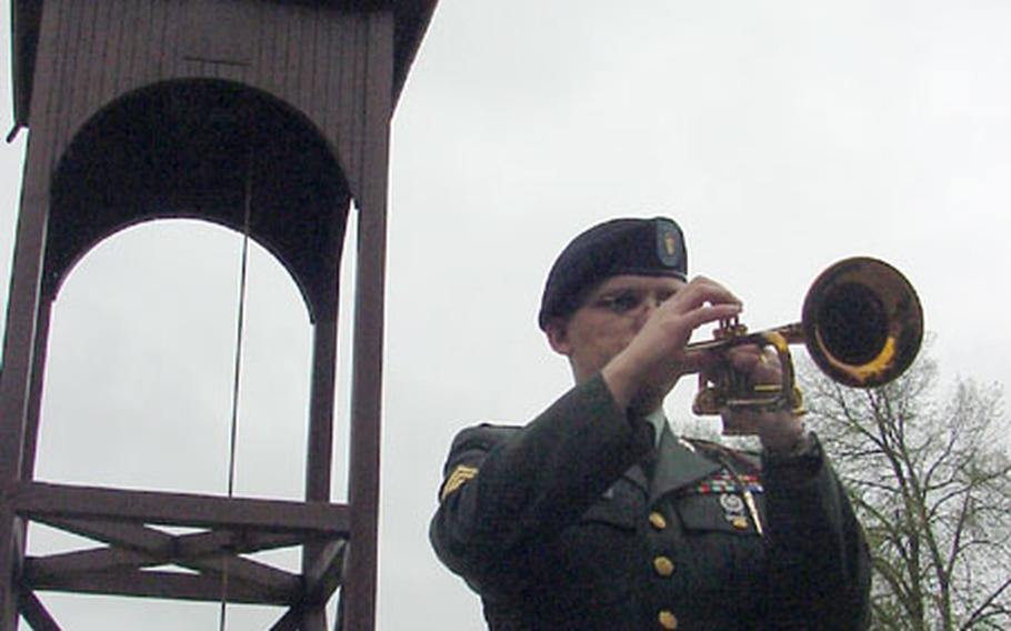 Sgt. Michael Daly, 1st Infantry Division Band, plays taps at Thursday's memorial service for Spc. Martin Wilson Kondor.
