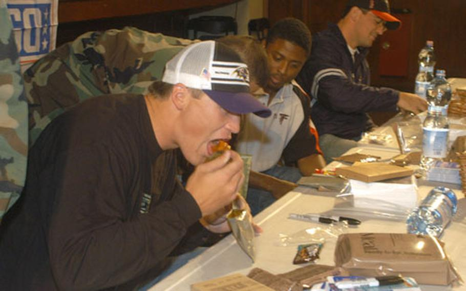 To help better understand soldier living, Todd Heap, tight end for the Baltimore Ravens, tries the chicken and salsa Meals, Ready to Eat.
