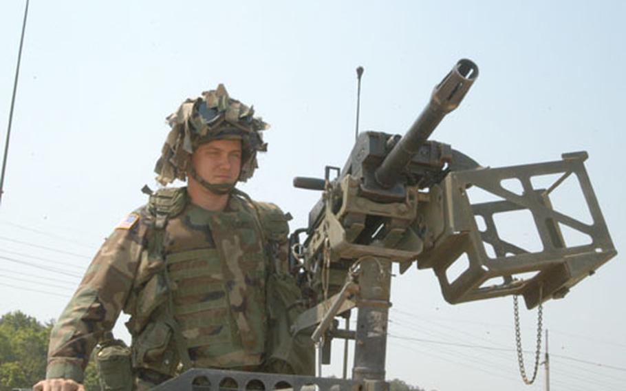 Spc. Jeremy Lentz preparing to shoot the Mark 19 grenade launcher in Warrior Valley on Thursday.