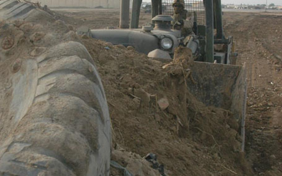 A gag-inducing stench of rotting trash filled the air in January as Pfc. Marcus Bradley, 25, of Providence, R.I., drove his bulldozer into a large mound of dirt and debris at Abu Ghraib prison in Iraq.