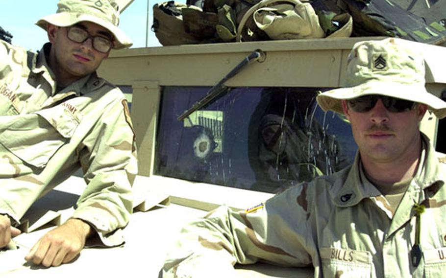 OK, it's not pretty, but the ballastic windscreen glass did what it's supposed to do — stop an roadside bomb blast from injuring truck commander Staff Sgt. Adam Bills, right, and his driver, Pfc. Adam Logan.