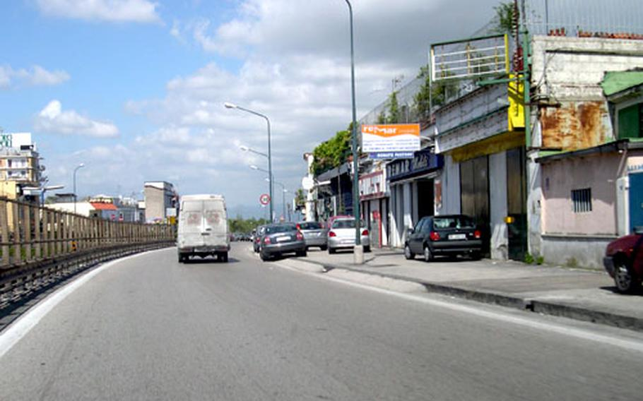 On weekends, flower vendors line the side of this road, on the main route from the Capodichino main gate to the support site housing area in Naples, Italy. It was along this road late last year that men attempted to enter Petty Officer 2nd Class Eric Brown's car. As he sped away, Brown saw a man lying on the side of the road covered in blood. A survey of Neapolites shows residents believe crime is the city's biggest problem.