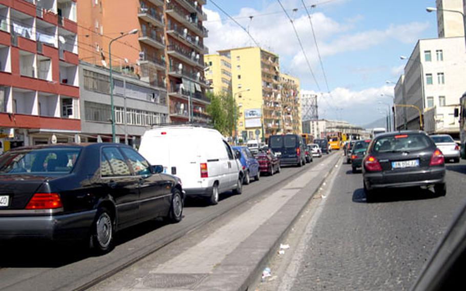 Traffic in Naples can never be called orderly, as seen here by the cars packing the off-limits transit-only lane. Add cobblestone streets, windshield washers, tissue paper salesmen and the occasional thief or carjacker, and Naples becomes a challenge for drivers.