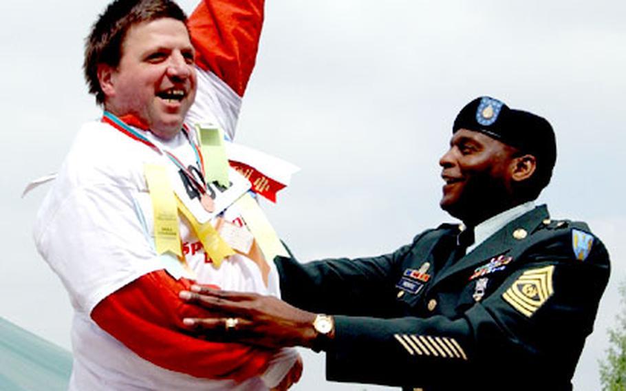 Command Sgt. Maj. Sam Morris of the 29th Support Brigade in Kaiserslautern, Germany, congratulates Michael Schuff.