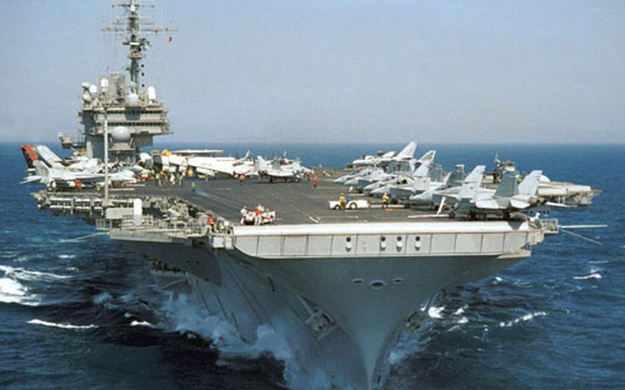 Navy officials announced that the USS Kitty Hawk, a 45-year-old aircraft carrier powered by steam turbine engines, is scheduled to remain in Japan through 2008.