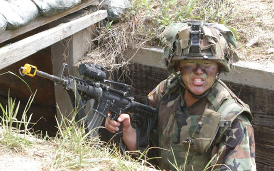 The leader of 1st Platoon, B Company, 2-9 Infantry Regiment 2nd Lt. Rank Hwang reacts to a surprise attack at Mohawk Range.