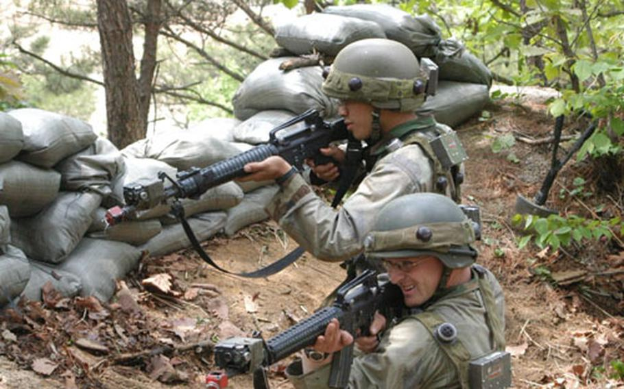 Opposition Force soldiers fight soldiers from 3rd Platoon, B Company, 2-9 Infantry Regiment in Warrior Valley.