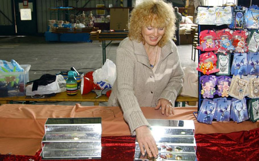 Ann Chapman, with Suffolk Bears and Gifts, sets up a display Thursday for the Rhein-Main Air Base bazaar. Organized by the Rhein-Main Community Spouses Club, it is the final bazaar before the base closes in December 2005.