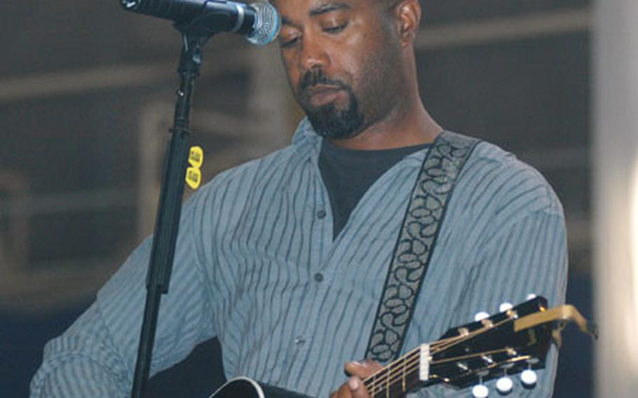 Darius Rucker, lead singer for Southern pop rock band Hootie and The Blowfish, rehearses at Misawa Air Base, Japan, Friday afternoon for the evening's concert.