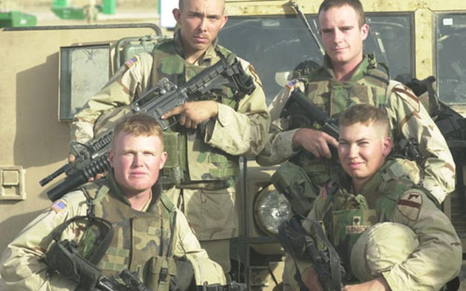 Scouts say that plain hard work, especially random traffic stops, can net crucial intelligence on the enemy. His soldiers, says 1st Lt. Rich Groen, front row left, have found everything from IEDs to lists of terrorist leaders complete with addresses. Next to Groen is Spc. Robert Loney. In the back row are Pvt. Anthony Ventura, left, and Pvt. Jacob Hounshell.