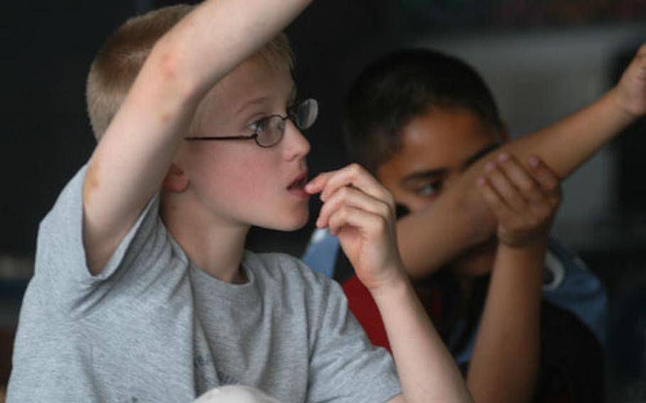 Cody Bergen, left, and Bryan Acosta, 11, ask questions during a Risk Watch water safety class at Naples Elementary School.