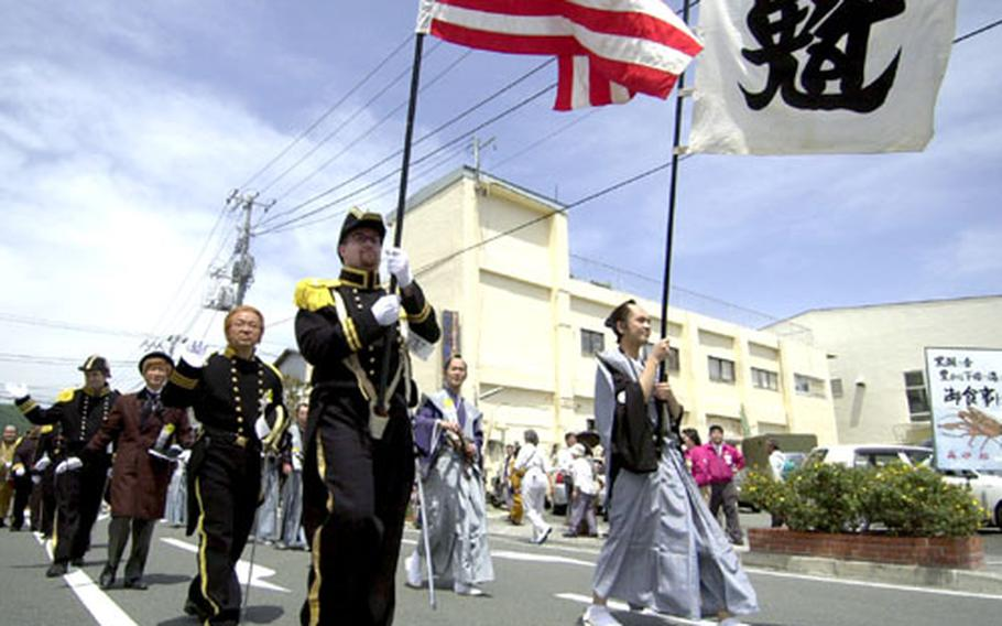 Men dressed up as Commodore Matthew Perry and Japanese lords reminiscent of 1854 signing of the U.S.-Japan Trade and Amity Treaty paraded through Shimoda City during the 65th Annual Black Ship Festival.