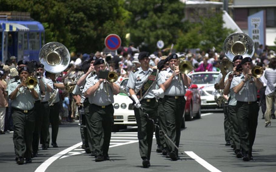 The U.S. Army Japan Band parades to a full crowd through the streets of Shimoda City on Saturday.