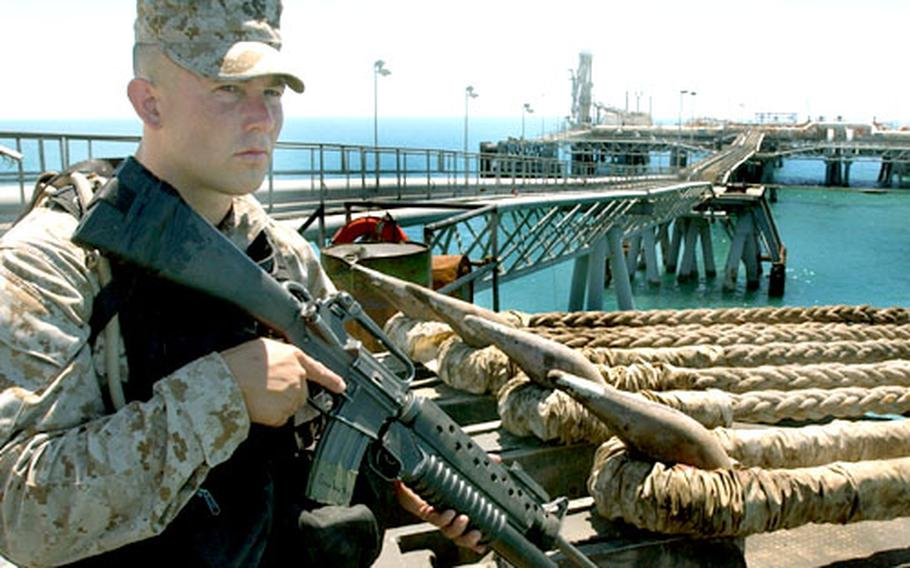 A U.S. Marine stands security watch on the deck of the Al Basrah oil terminal. U.S. Marines from the 1st Fleet Anti-Terrorism Security Team Battalion of Norfolk, Va., are providing extra security along with the Iraqi security teams after an April 24 attack that killed three servicemembers.