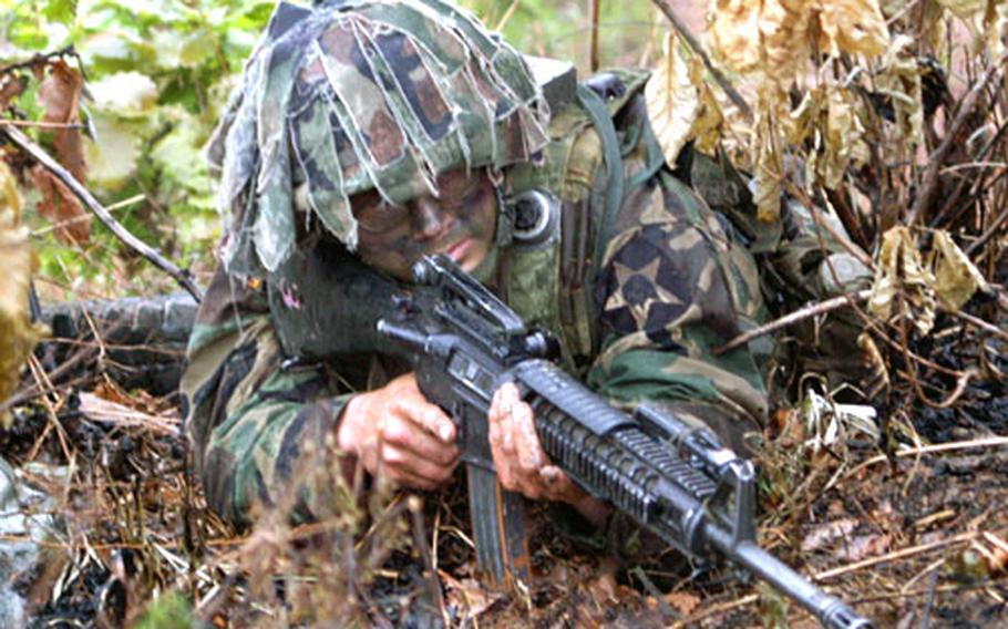 A soldier from Company D, 2nd Battalion, 9th Infantry Regiment guards Objective Niner on Rodriguez Range.