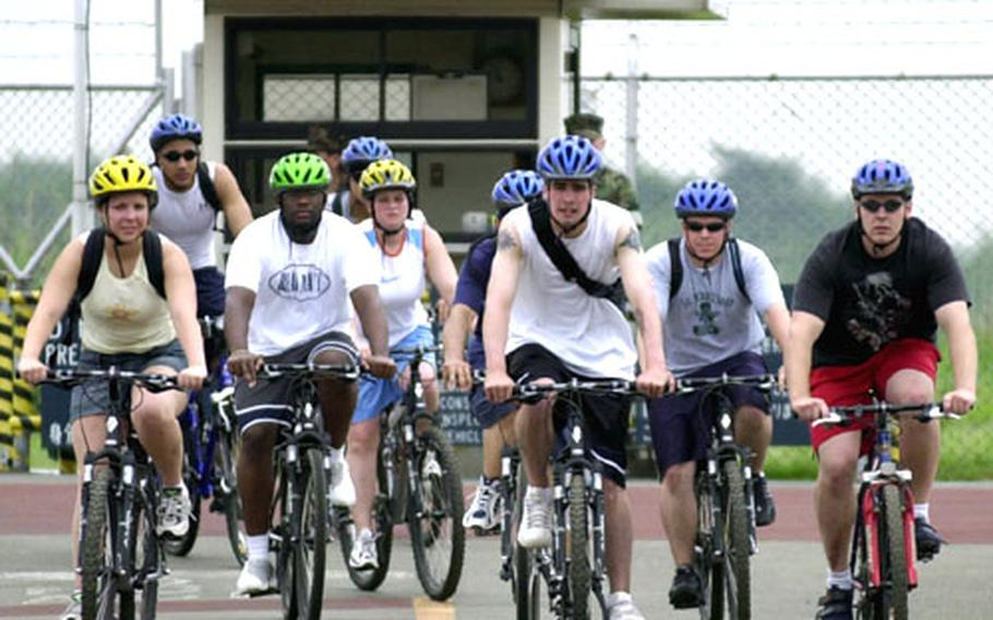 The Atsugi Naval Air Facility Security Bicycle Patrol rides out of Naval Support Facility Kamiseya as part of the two-day training program.