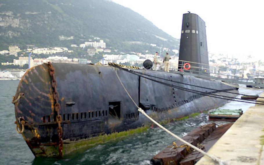 The World War II-era submarine USS Razorback moored Tuesday in Gibraltar. Navy veterans are bringing the submarine from Turkey to an Arkansas riverfront museum.