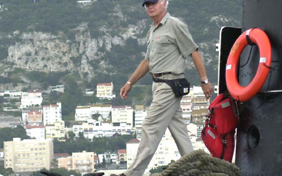 Navy veteran Bob Opple walks on the USS Razorback on Tuesday in Gibraltar.