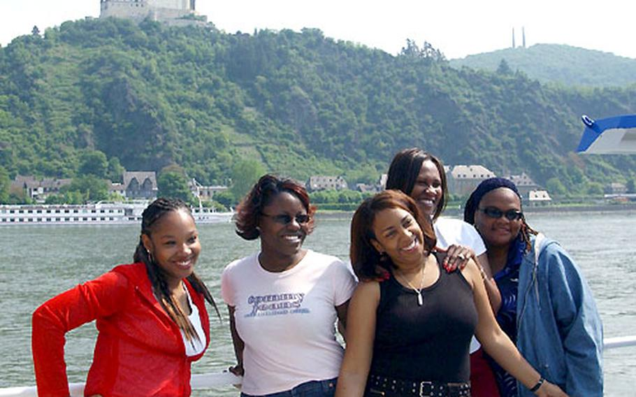 Risa Knight, Matilda Adams, Shelly Feathers, Camille Jackson and Tanya Brown pose for a picture in front of Marksburg Castle during a free Rhine River cruise for Baumholder military spouses and family members on Tuesday.