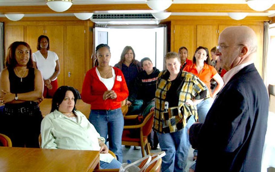Paul Prengel talks to Baumholder military spouses and family members during the Rhine River cruise.