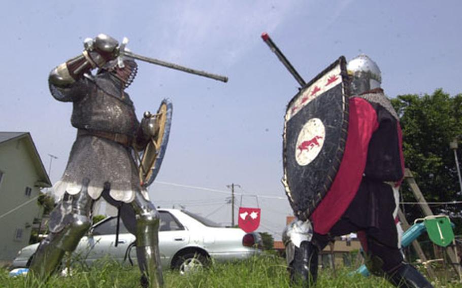 "Jay Noyes, on the left, as ""Lord Noe,"" battles Mark Iacampo's ""Lord Codogan."""