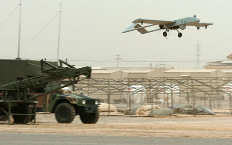 The 1st Infantry Division's Tactical Unmanned Aerial Vehicle takes flight during a test run at Forward Operating Base Remagen, Iraq, on May 10. The vehicle is launched from a hydraulic rail launcher.