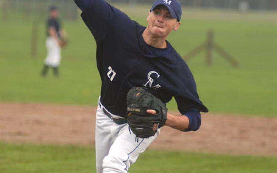 Senior Airman Eric Baxter of the 48th Equipment Maintenance Squadron at RAF Lakenheath, England, delivers a pitch during a baseball game at RAF Feltwell, England.