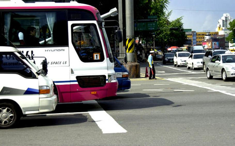 Beginning June 1, if your vehicle is over the white line at an intersection in Seoul, you will face an immediate fine.