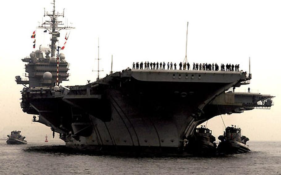 The USS Kitty Hawk returns from deployment.