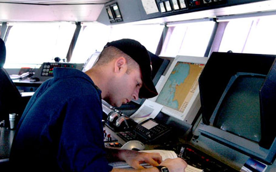 HSV Joint Venture navigator Sgt. Mike Griffin works in the vessel's control room at Sattahip Naval Base, Thailand.