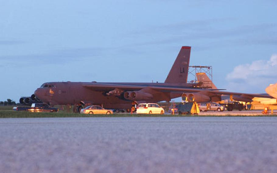 A pair of B-52 Stratofortresses arrives at Andersen Air Force Base on Tuesday evening.