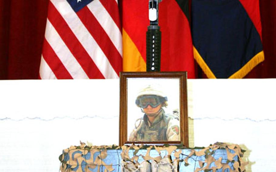 A memorial display for Spc. Michael Campbell sits in front of the chapel in Schweinfurt, Germany, on Wednesday. Campbell was killed in Iraq on May 19.