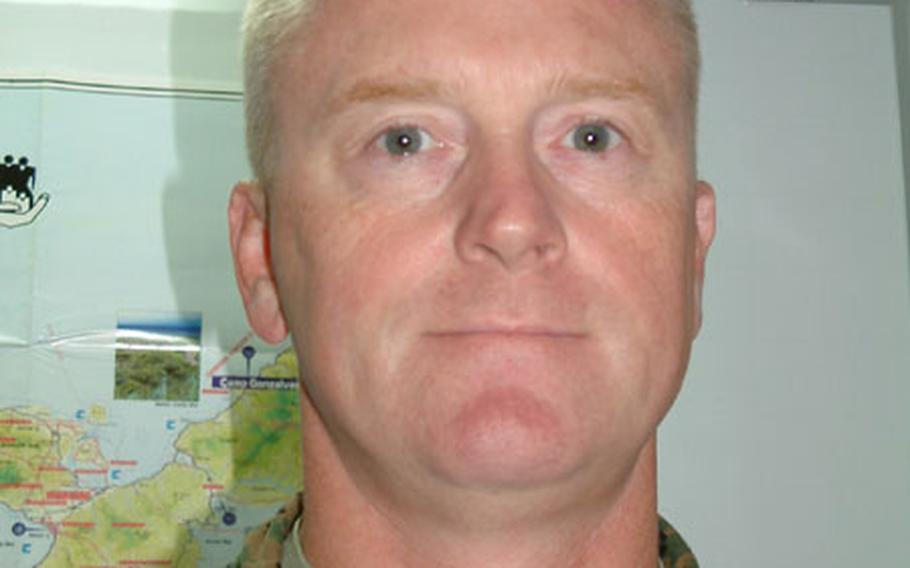 Lt. Col. Kevan B. Kvenlog, Provost Marshal, Marine Corps Bases Japan.
