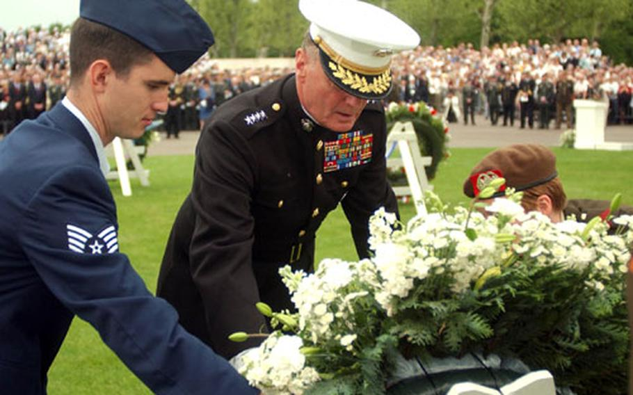 Gen. James Jones, center, commander of the European Command, lays a wreath Sunday during a Memorial Day ceremony at the Netherlands American Cemetery and Memorial in Margraten, Netherlands.