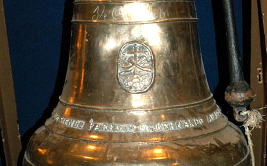 The history of the Balangiga Bell, seen on display at at the 2nd ID Museum at Camp Red Cloud, South Korea in 2004, is under debate. The 2nd ID claims townspeople presented it the bell in 1902, while a new book says U.S. troops seized the bell after burning the town.