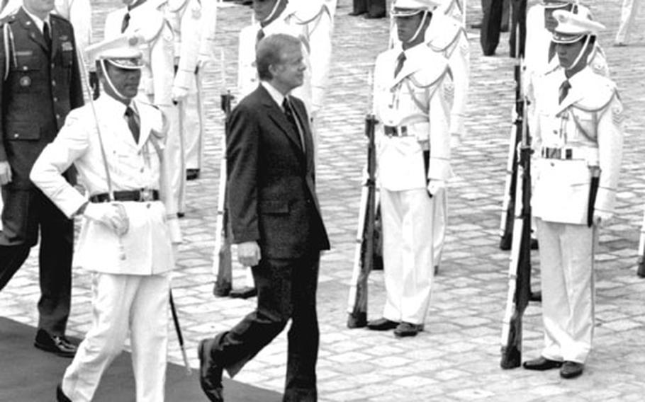 President Jimmy Carter troops the line of the honor guard at Akasaka Palace, where he was to meet with Emperor Hirohito, in June, 1979.